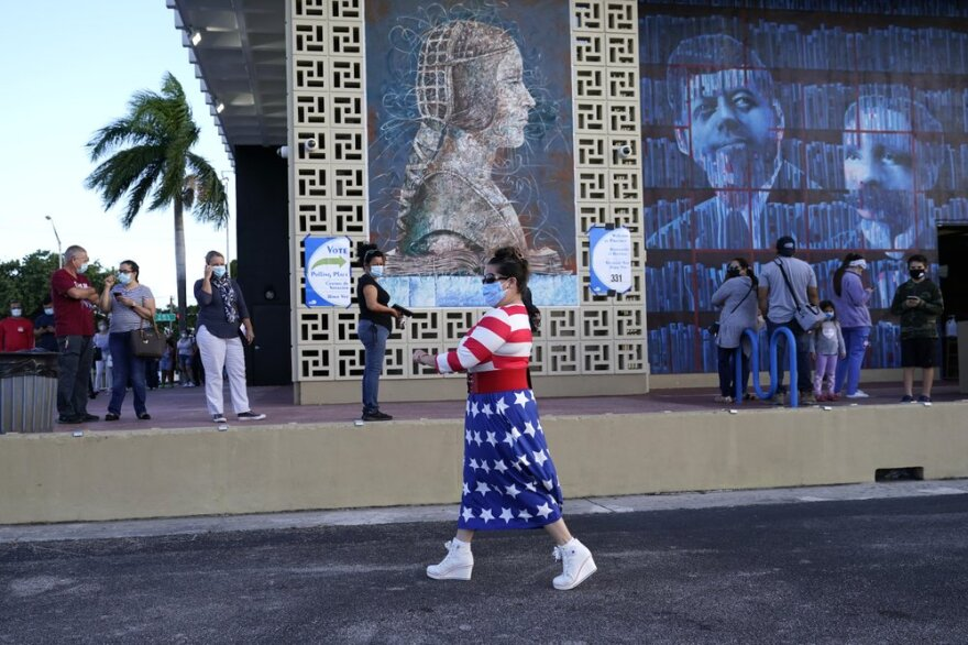 Yanitza Martinez wears red, white, and blue as she arrives to vote outside of the John F. Kennedy Library during the general election Nov. 3, 2020, in Hialeah, Fla.