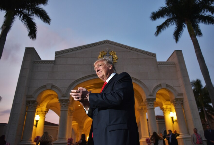 President Trump watches the Palm Beach Central High School marching band perform upon his arrival at Trump International Golf Club Palm Beach in West Palm Beach, Fla., to watch the Super Bowl on Feb. 5.