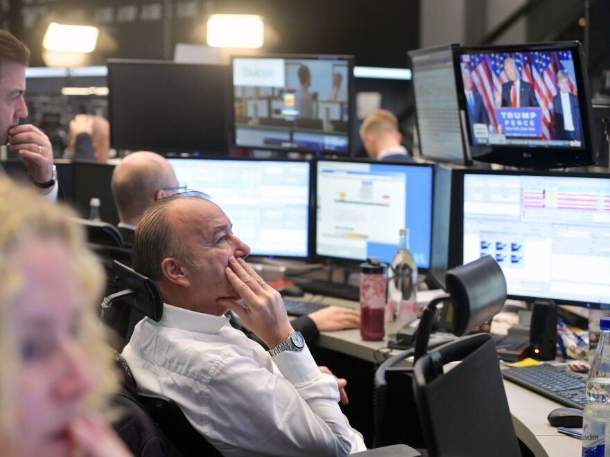 Traders watch the speech of Donald Trump, after he wins the U.S. presidential elections, at the Frankfurt Stock Exchange on November 9, 2016 in Frankfurt, Germany.