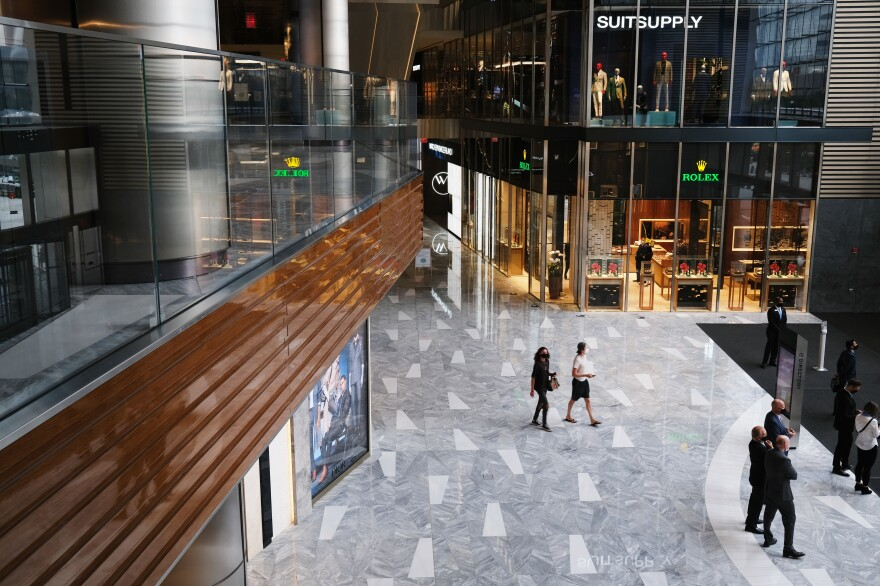 People walk through the newly reopened mall at Hudson Yards in New York. U.S. shoppers spent more prudently in August and retail sales grew a tepid 0.6% from July.