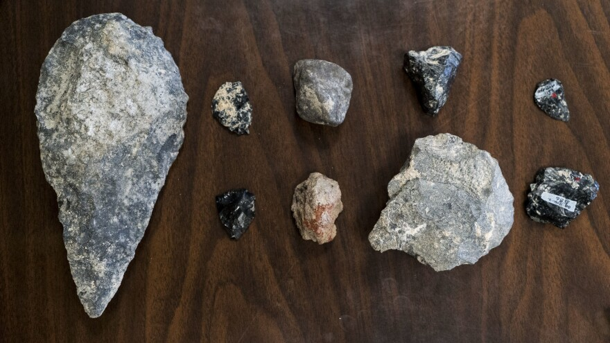 Assortment of Early and Middle Stone Age tools found in the Olorgesailie Basin, Kenya. The tool at left is a hand axe.