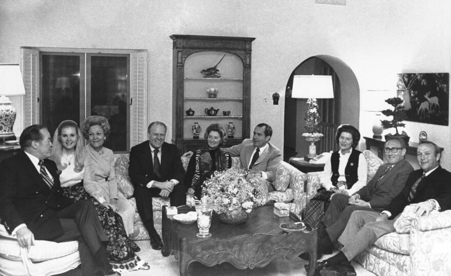 Gathered in the living room of the president's home at the Western White House in San Clemente on Jan. 6, 1971, are (from left to right): Bob Hope; Tricia Nixon; Pat Nixon; Gerald Ford, then minority leader of the House; Dolores Hope, Nixon; Betty Ford; Henry Kissinger; and Arnold Palmer.