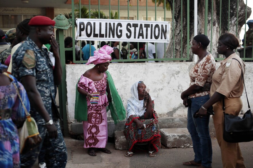 Gambians wait to cast votes at a polling station Thursday in Banjul.