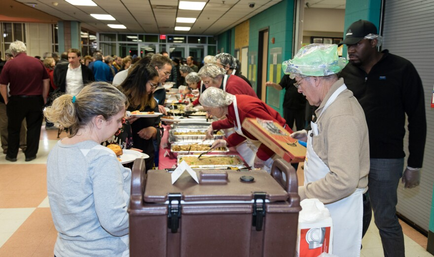 Turnout was high at a local potluck organized to help furloughed federal workers during the shutdown.