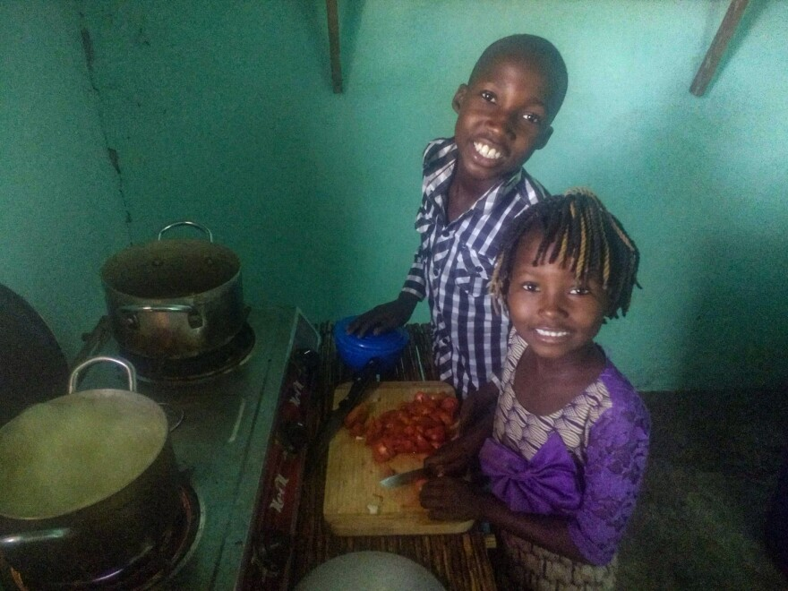 Asaph and Arielle Kantika, two of the kids from the family that hosted Peace Corps volunteer Abby Reilly, helped make sauce for the spaghetti omelet Thanksgiving meal.