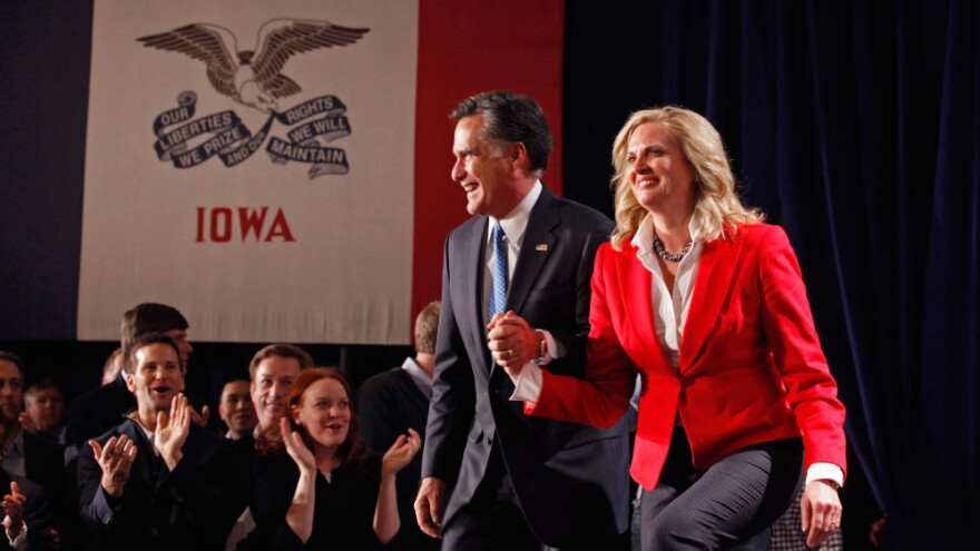 Former Massachusetts Gov. Mitt Romney and his wife, Ann, take the stage Tuesday at the Hotel Fort Des Moines to celebrate the former governor's showing in the Iowa caucuses.
