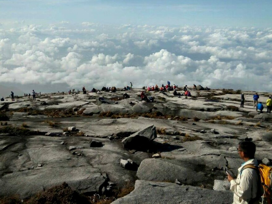 Hikers trapped on Borneo's Mt. Kinabalu on Friday after a magnitude-5.9 earthquake triggered avalanches that closed off the decent route.