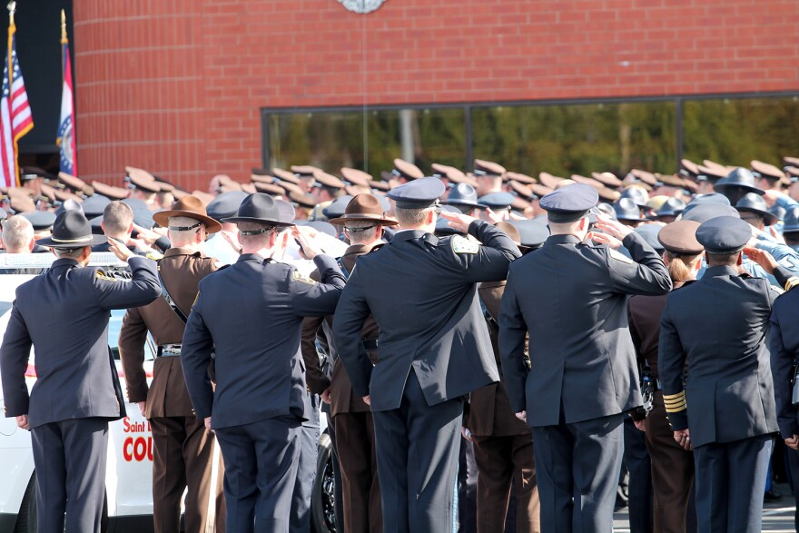 A sea of uniformed officers give Blake Snyder a final salute before the St. Louis County Police officer's funeral Thursday, Oct. 13, 2016 at St. Louis Family Church in Chesterfield.