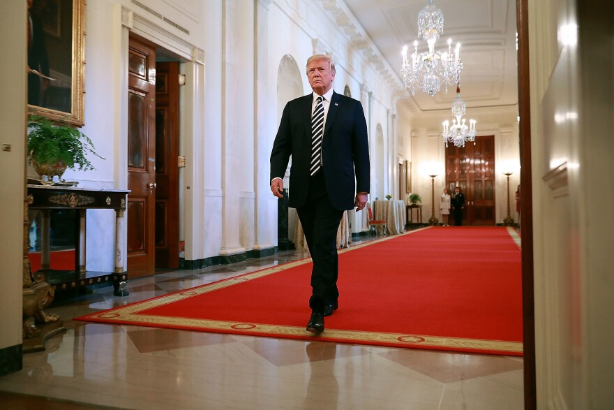 President Trump walks into the East Room of the White House on Wednesday. He has acknowledged that his lawyer paid $130,000 to actress Stormy Daniels.