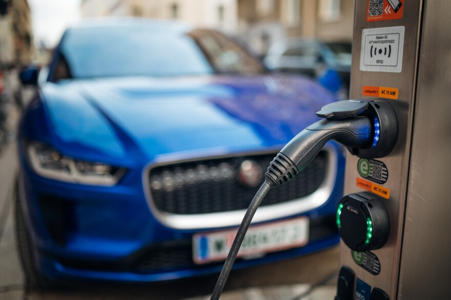 Close-up of an electric car charging station. Electric vehicle in a blurry background