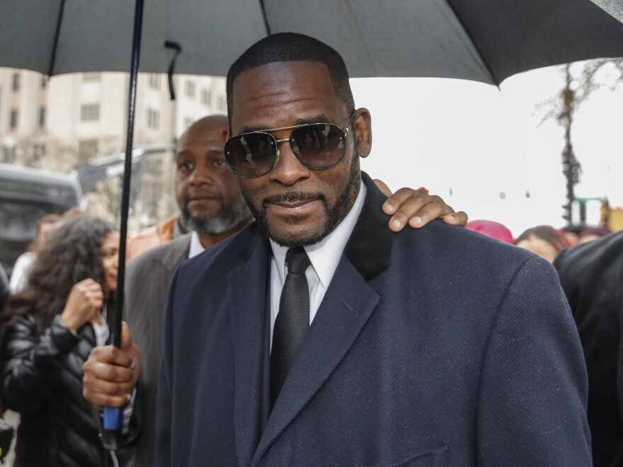 "An attorney for R. Kelly, seen in May 2019, said his client ""had nothing to do with any of these alleged acts by those charged."""