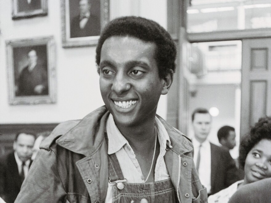 """Stokely Carmichael, chairman of the Student Nonviolent Coordinating Committee, speaks to reporters in Atlanta in May 1966. That year, his use of the phrase """"black power"""" at a rally in Mississippi grabbed the nation's attention."""