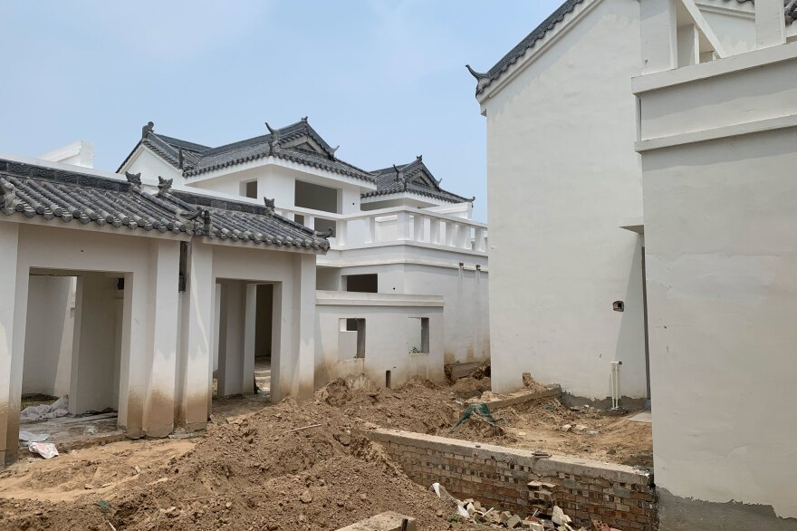 Homes under construction that villagers in Xiguozhuang and Liushuanglou are being asked to buy and move into. The houses are aesthetically pleasing, says Liu, but they are incompatible with the rural lifestyle. For example, farmers require a large yard to dry their crops after harvest each season.