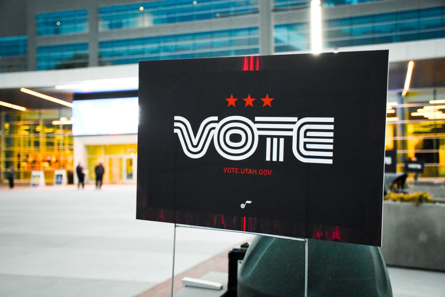 A photo of a sign that says 'vote'.