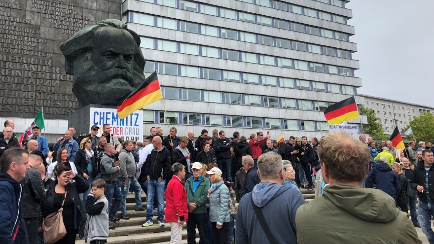 Far-right demonstrators gather in front of the Karl Marx Monument in the German city of Chemnitz on Saturday.