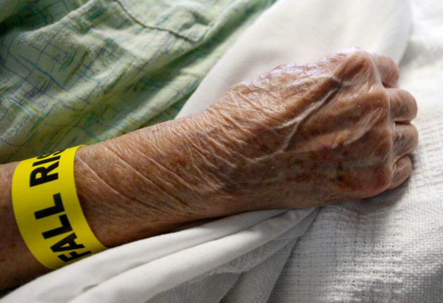 an elderly person's wrist