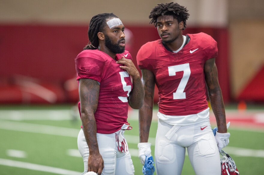 Alabama defensive back Shyheim Carter, left, chats with Trevon Diggs during a Crimson Tide practice.