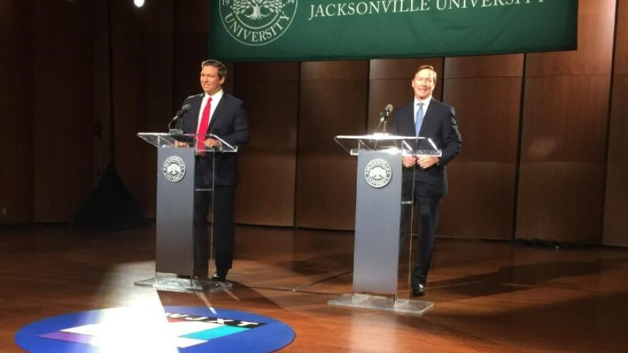 Ron DeSantis (left) and Adam Putnam shared the stage at Jacksonville University Thursday night for a debate.