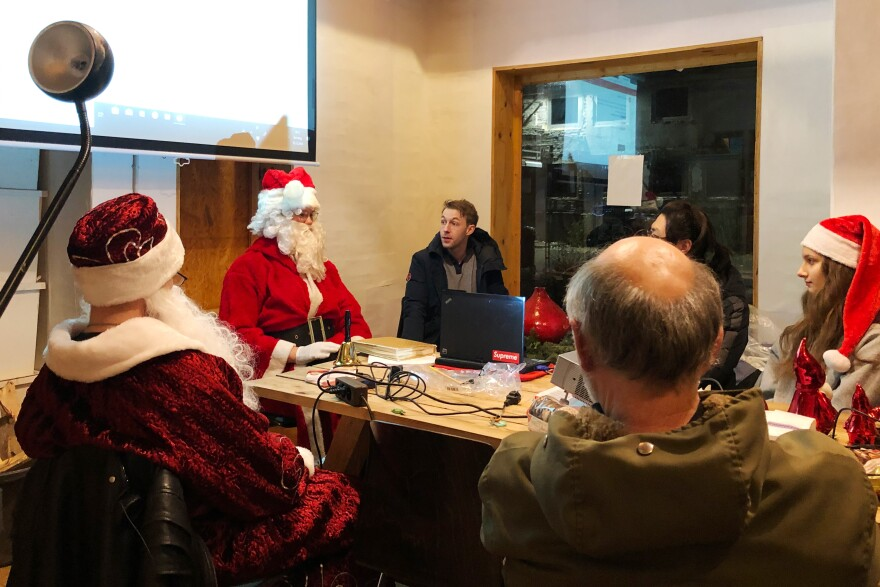 Dressed as Santa, Tim Zander gives pointers on how to be the perfect Santa to applicants at a workshop run by Weihnachtsmann2Go (Santa2Go).