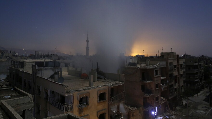The U.S. plans to send up to 50 members of its Special Operations Forces to Syria to help fight ISIS. They'll be entering a war zone with many combatants. Here, smoke rises from a building in the rebel-controlled area of Douma, east of Damascus, early Friday, after a reported shelling by Syria's government.