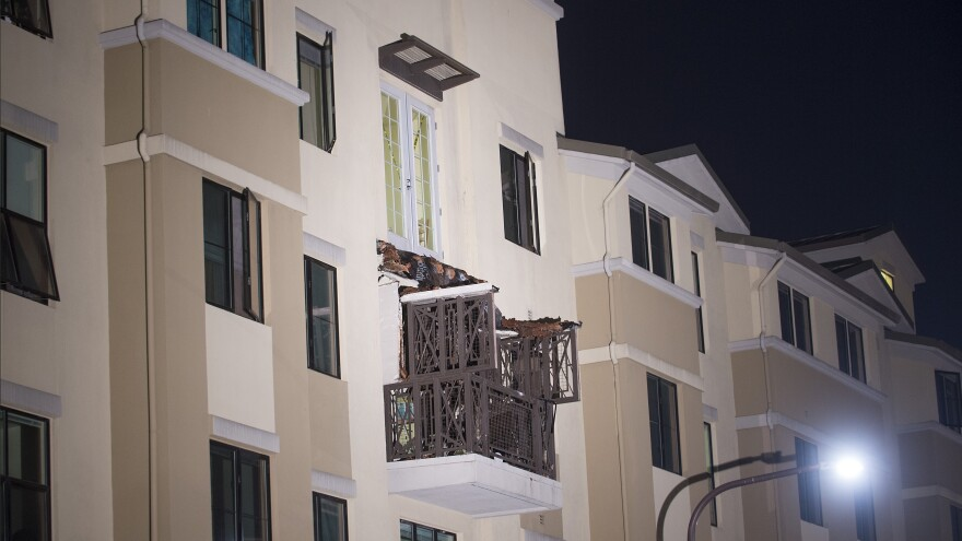 A fourth-floor balcony rests on the balcony below after collapsing at the Library Gardens apartment complex in Berkeley, Calif., early Tuesday.