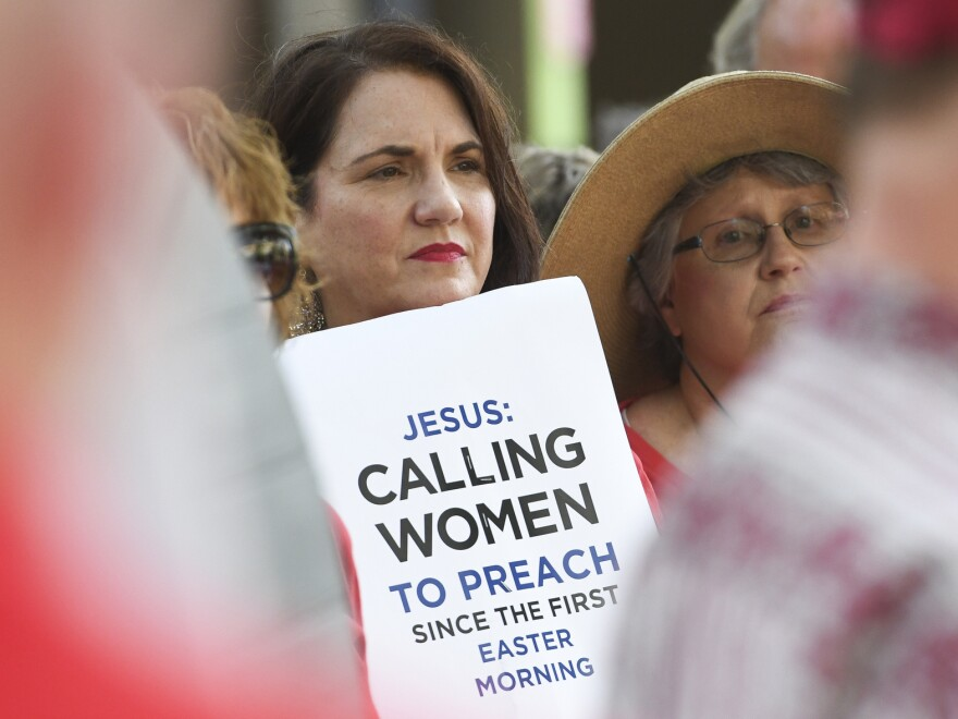 Janene Cates Putman of Athens, Tenn., demonstrates outside the Southern Baptist Convention's annual meeting on Tuesday, during a rally in Birmingham, Ala.