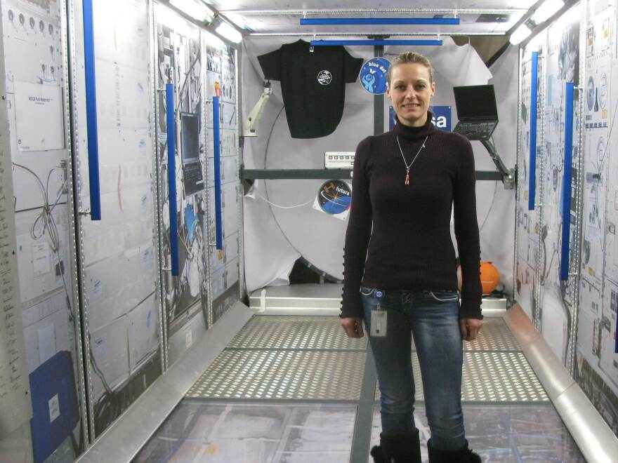 Katja Leuoth, the German Space Operations Center's first female flight director, stands inside a mock-up of the Columbus laboratory module of the International Space Station.