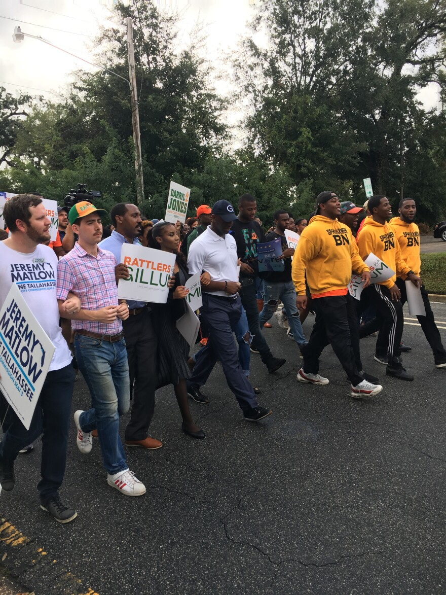 Front of Crowd marches down the street with Andrew Gillum at the center.