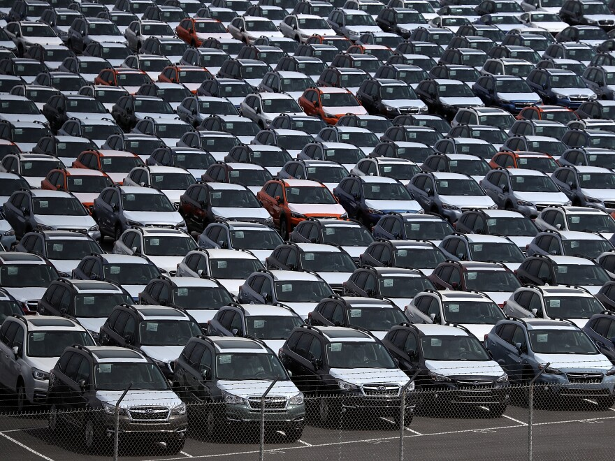 New cars sit in a lot at the Port of Richmond in California last year. The Trump administration on Friday announced a six-month delay in setting new tariffs on auto imports.