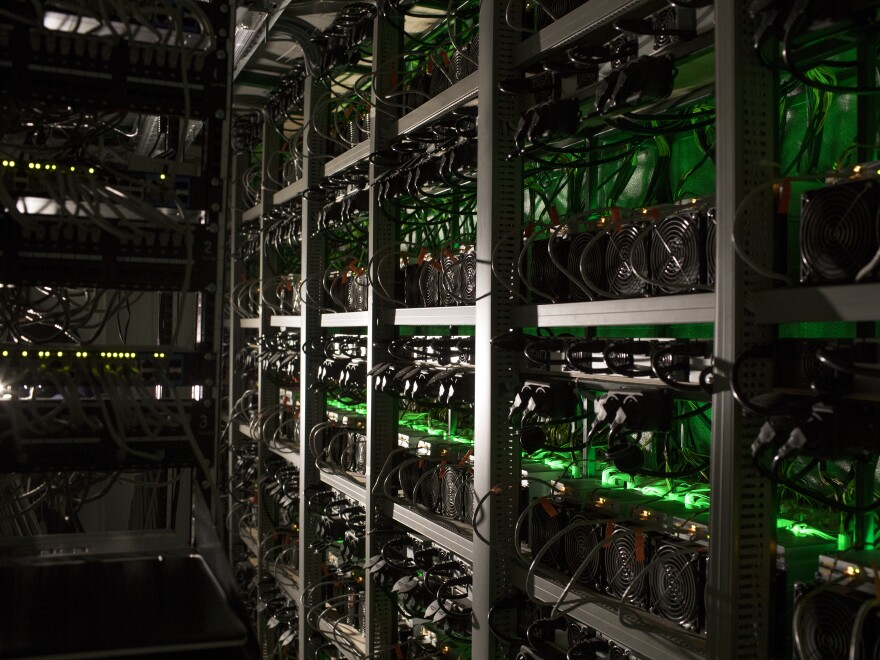 Cryptocurrency mining rigs operate at the Golden Fleece company in Kutaisi, Georgia. The company uses a cargo container with Chinese-built computers inside a dilapidated Soviet-era tractor factory to extract cryptocurrencies using low-cost electricity generated by water flowing from the nearby Caucasus Mountains.