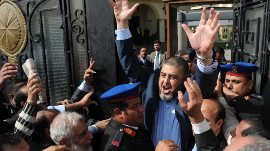 Khairat el-Shater, a leader of Egypt's Muslim Brotherhood, leaves the election committee headquarters in Cairo on Thursday after registering for the presidential election next month. A delegation from the Brotherhood is currently visiting Washington to talk about the group's plans for Egypt's future.