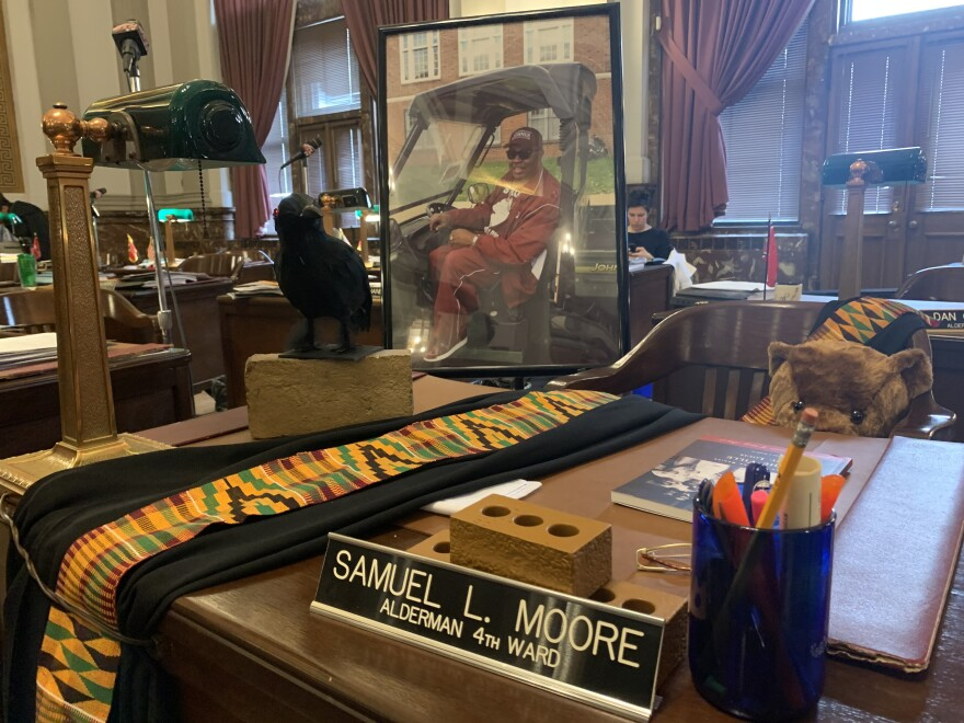 Aldermen decorated Sam Moore's desk for the board meeting on Friday. It was the first meeting since Moore's death. 2/28/2020