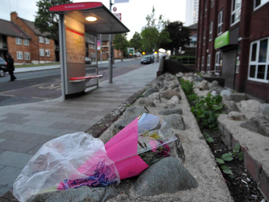 Flowers have been left near the site in south London where a British soldier was hacked to death Wednesday.