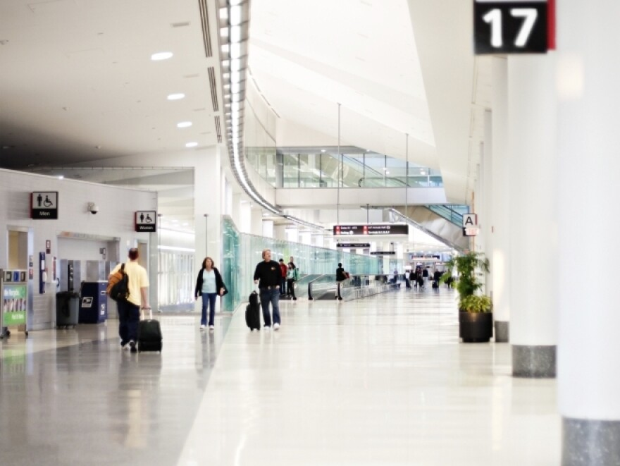 People travelling through Philadelphia International Airport Terminal A West Transit Corridor. The airport is the 12th busiest in the world.