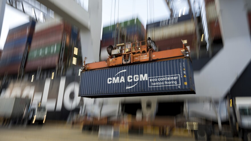 A crane lifts a shipping container from China onto a terminal at the Port of Savannah in Georgia. China's economy grew by just 6.1% last year, a sign that the trade war with the U.S. has taken a toll.