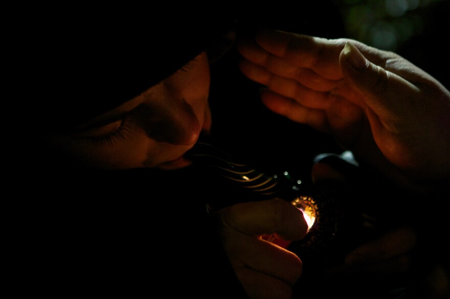 A resident of Tacoma, Washington smokes marijuana shortly before a law legalizing the recreational use of marijuana took effect in Seattle, Washington.