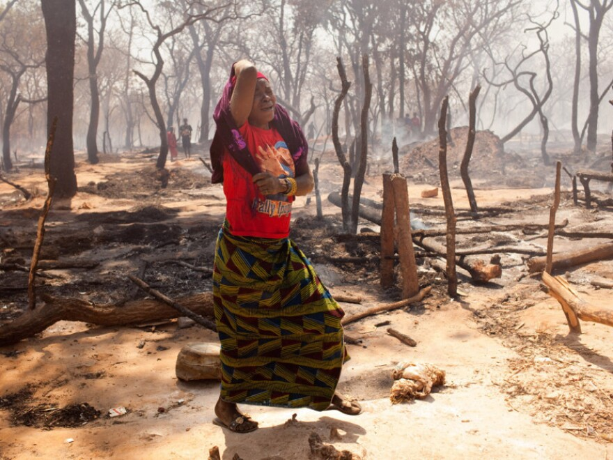 Approximately 100 thatched-grass homes and market kiosks were destroyed in the mining village's fourth fire in two months.