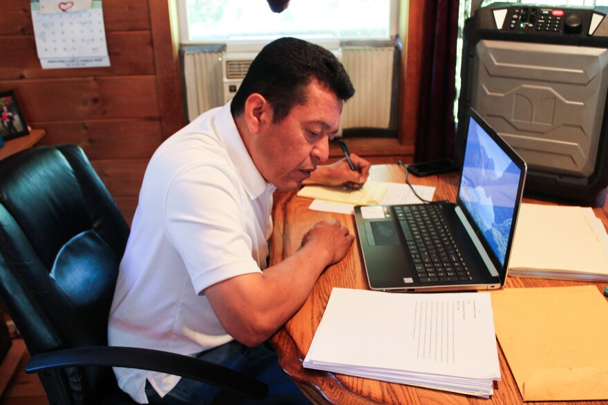 Dwayne Tomah listens to and transcribes an old Passamaquoddy story from a digital copy of a wax cylinder recording. Tomah and others in the Passamaquoddy tribe are translating and interpreting the 129-year-old wax cylinder recordings, which have been digitally restored.