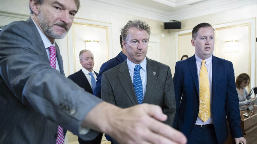 Sen. Rand Paul, center, and his communications director Sergio Gor, right, enter a hall during their meeting with Russian lawmakers in Moscow Monday.
