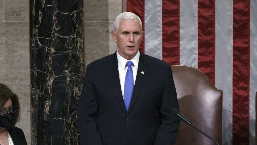 Vice President Pence reads the final certification of Electoral College votes cast in November's presidential election during a joint session of Congress early on Jan. 7