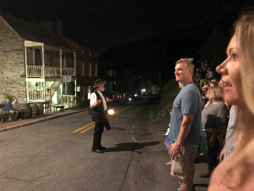 Garland telling one of his ghost stories to a large crowd in Harpers Ferry, W.Va.