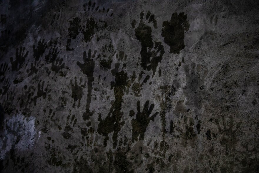 Handprints are left in the mountaintop temple of Lalish in northern Iraq — the holiest site in the Yazidi faith. Since the genocide, religious elders have conducted a ritual here to religiously purify women held captive by ISIS.