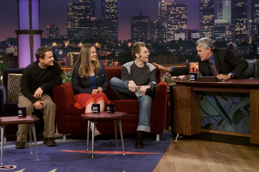 Left to right: Sean Watkins, Sara Watkins and Chris Thile chat with Jay Leno on <em>The Tonight Show</em> in June 2001.
