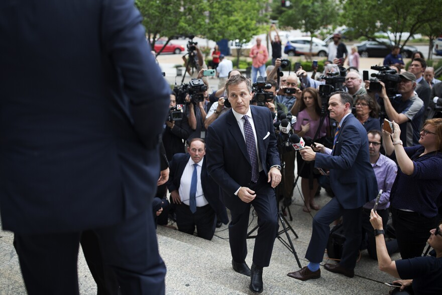 Gov. Eric Greitens walks away from reporters after making a statement outside the Circuit Court building. May 14, 2018