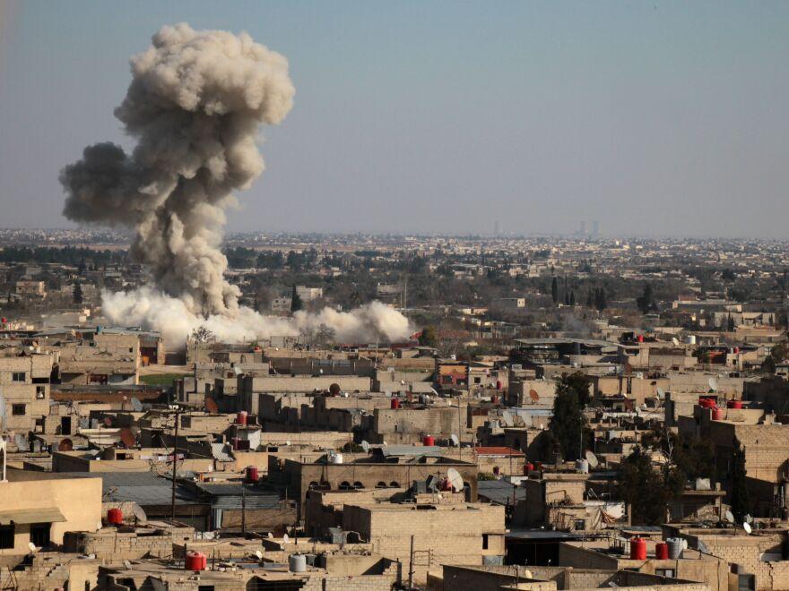 Smoke mushrooms skyward amid the bombardment Monday on rebel-held Eastern Ghouta.