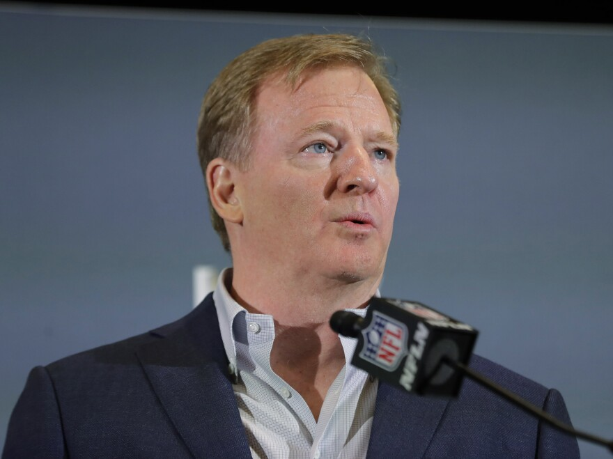 The NFL has set protocols for reopening team facilities, a process that begins as early as Tuesday. NFL Commissioner Roger Goodell is shown here speaking in Miami in February.