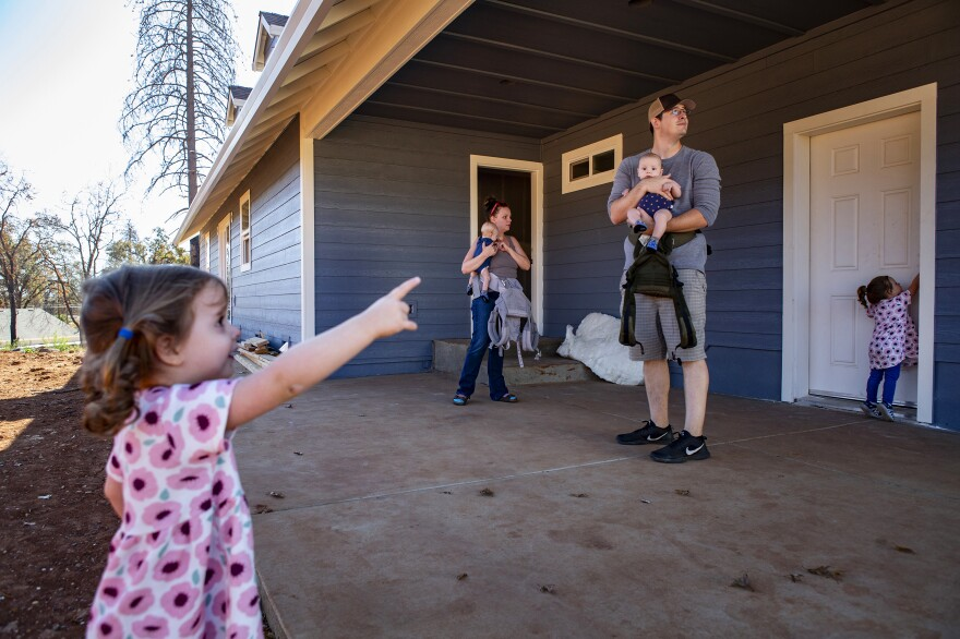 Noah and Chelsea take their kids to look at the new house they're rebuilding in Paradise.