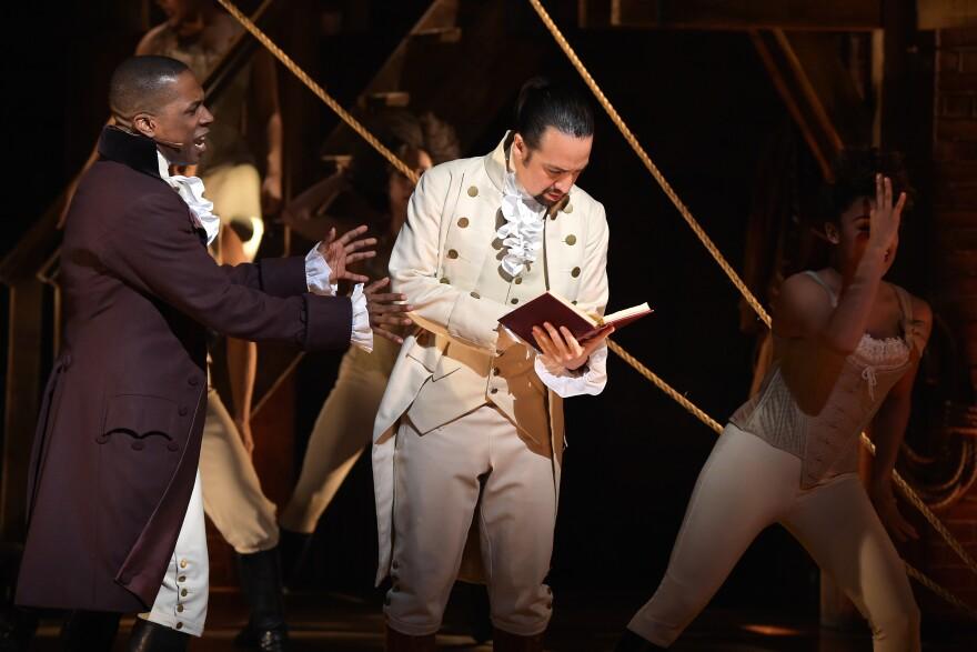 Actor Leslie Odom, Jr. (left) and actor, composer Lin-Manuel Miranda (right) perform on stage during the <em>Hamilton</em> Grammys performance.
