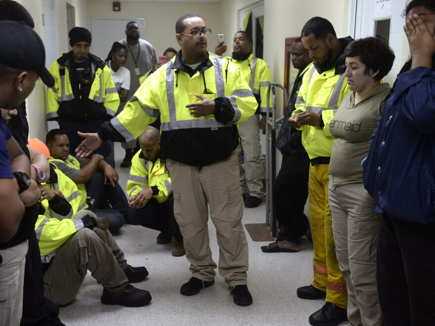 A rescue team waits to assist in the aftermath of Hurricane Maria in Humacao, Puerto Rico, on Wednesday.