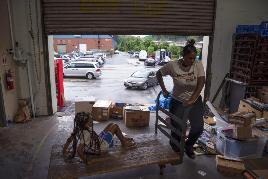 Lyric, daughter of the Baltimore Teacher Supply Swap's operations coordinator Kiyawna West, often volunteers at the Teacher Supply Swap, a free store for educators in northern Baltimore.